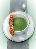 Cream of pea soup with crisp bacon