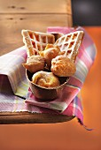 Donuts and waffles sprinkled with icing sugar