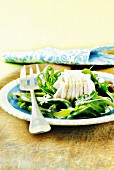 Steamed skate with capers and rocket lettuce with white sauce