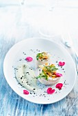 Sole black pearl curry rolls ,spring vegetables with lemon
