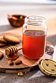 A jar of honey and shortbread biscuits