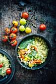 Porridge mit Kichererbsen und Kirschtomaten