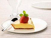 Slice of lemon curd pie topped with strawberry sorbet