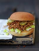 Shredded pork and caramelized onion sauce burger