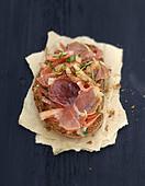 Raw ham and basil bruschetta