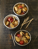 Mussels marinated with tomatoes and peppers