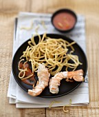 Langoustines grilled with lardo di colonnata and fried spaghettis