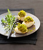 Scallop snacks with pistachio and orange zest topping