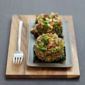 Rocket lettuce,tomato and sesame timbale on a bed of nori seaweed
