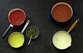 Variety of sauces in saucepans