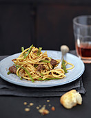 Spaghettis with beans and spicy beef