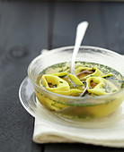 Herb broth with cheese raviolis