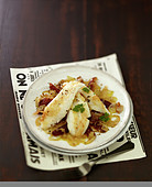 John Dory fillets with browned onions and dates