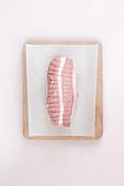 Raw pork roast on a sheet of wax paper