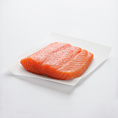 Piece of raw salmon on a white background