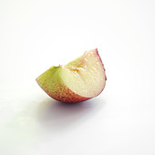 Quarter of a white nectarine on a white background