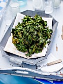 Kale cabbage sauteed with soya sauce and sesame seeds