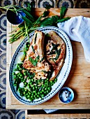 Grilled veal chops, fresh peas with sage