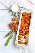 Preparing a yellow and red cherry tomato tart