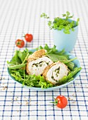 Rolled chicken bread with herbs and sesame seed crust
