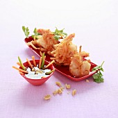 Shrimps in peanut and onion crust, vegetable sticks with vinaigrette