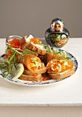 Russian apertif :salmon rolls stuffed with scrambled eggs, fish roe and dill on toasts
