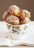 Bugnes coated in white breadcrumbs and icing sugar