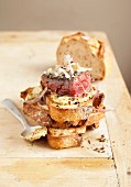 Beef back steak with shallots and mustard on sliced bread