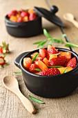 Strawberry, yellow tomato, pineapple tomato and savory salad