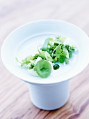 Fromage frais and peas with onions, celery stalks, dill and watercress