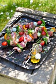 Pork and vegetables skewers on the barbecue