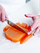 Taking the preparation out of the mould and cut into cubes