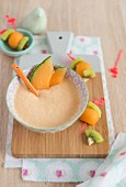 Melon mousse and mini melon-kiwi brochettes