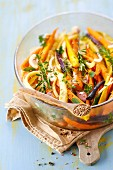 Old-fashioned carrot salad with fresh herbs and sesame seeds