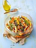 Old-fashioned carrot warm salad with fresh herbs and sesame seeds