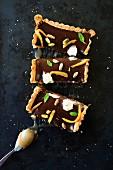 Chocolate caramel tart with pistachios and confit orange
