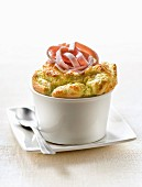 Individual split pea soufflé topped with thin strips of ham