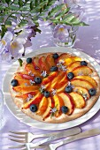 Nectarine, blueberry and rosemary flower thin tart