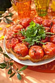 Tomato and thyme tatin tart with rocket lettuce and basil