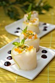 Green apple and fresh goat's cheese makis with crushed pistachios, diced apricots and cherry jam