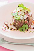 Tuna, ginger, sesame and wasabi tartare with radishes, cucumber and coriander