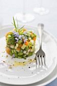 Vegetable tartare in herb aspic
