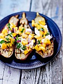 Roasted aubergines with Greek yoghurt and mango salsa, red onions and coriander