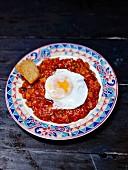 Pisto, vegetable ratatouille with an egg