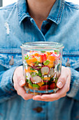 Radish, spinach, carrot, broad bean, sprout, cherry and feta salad jar