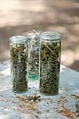 Assortment of herbal teas in jars