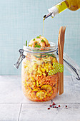 Orange lentil, yellow courgette, sweet corn, yellow tomato and shrimp salad jar