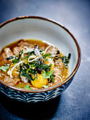 Thai broth with veal and sesame meatballs and polenta balls