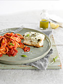 Grilled sea bass fillet, spaghettis in tomato sauce