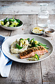 Piece of salmon coated in breadcrumbs and herbs, celeriac mash, broccolis and green beans